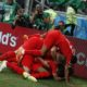 Players of England celebrate after scoring the winning goal against Tunisia.