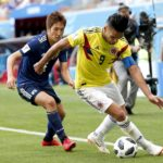Radamel Falcao of Colombia and Genki Haraguchi of Japan.