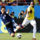 Genki Haraguchi (of Japan and Jose Izquierdo of Colombia battle for the ball.