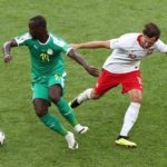 Grzegorz Krychowiak of Poland and Moussa Konate of Senegal.