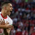Granit Xhaka of Switzerland celebrates scoring against Serbia.