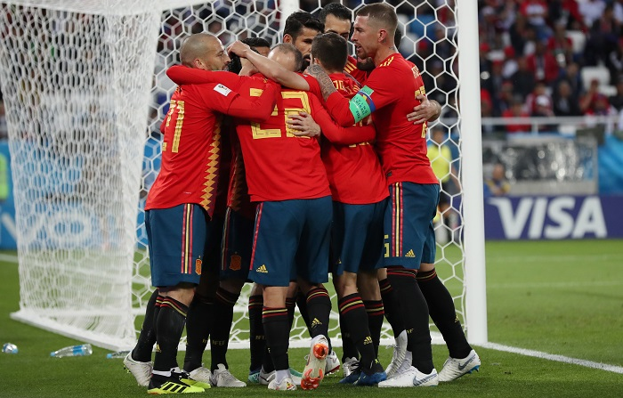 Players of Spain celebrate against Morocco.