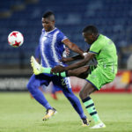 Willem Mwedihanga clears ball from Mohau Mokate