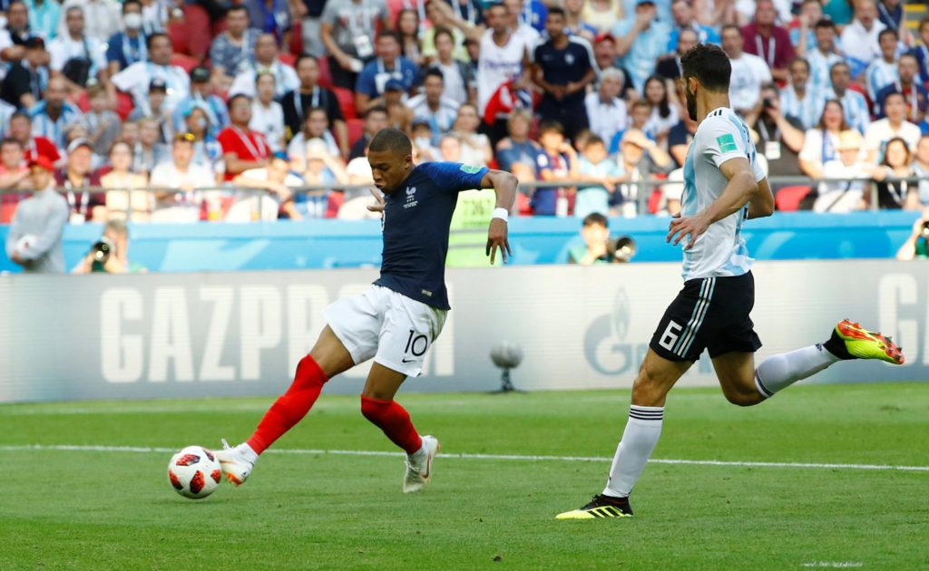 Kylian Mbappe slots home his second against Argentina