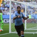 Luis Suarez celebrates his winning goal against Saudi Arabia
