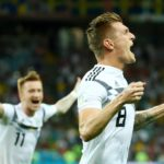 Toni Kroos celebrates his goal against Sweden