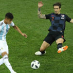 Maximiliano Meza of Argentina passes the ball past Sime Vrsaljko of Croatia