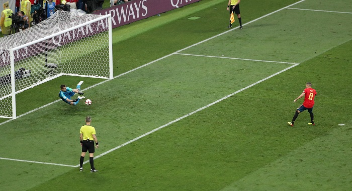 Goalkeeper Igor Akinfeev of Russia saves the penalty of Koke of Spain.