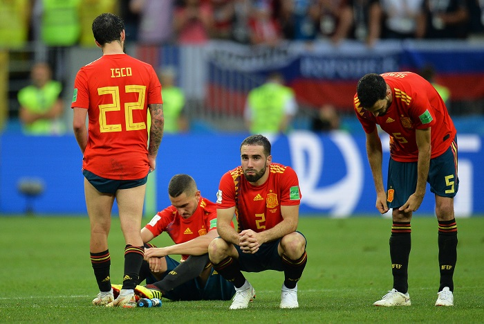 Players of Spain react after losing to Russia on penalties.