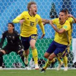 Emil Forsberg of Sweden reacts with Mikael Lustig of Sweden celebrate taking the lead.