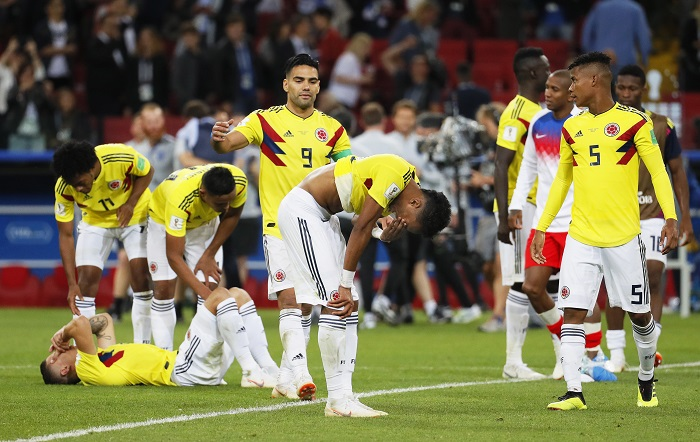 Players of Colombia react after the penalty shootout loss to England.