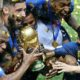 Players of France celebrate with the World Cup trophy.