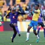 Themba Zwane of Mamelodi Sundowns challenged by Willard Katsande of Kaizer Chiefs