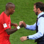 Ashley Young and Gareth Southgate of England.