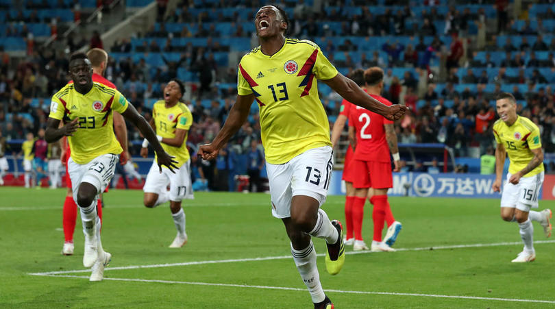Yerry Mina celebrates his goal against England