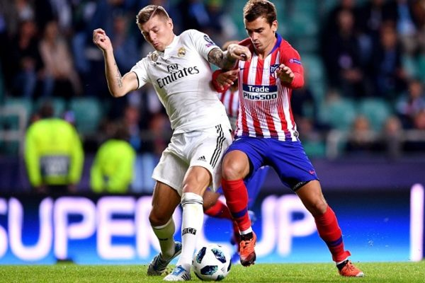 Antoine Griezmann of Atletico Madrid and Toni Kroos of Real Madrid.