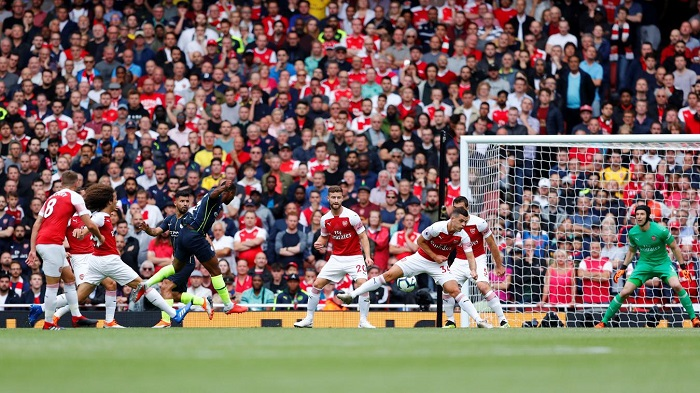 Raheem Sterling of Manchester City scoring his side's opener against Arsenal.