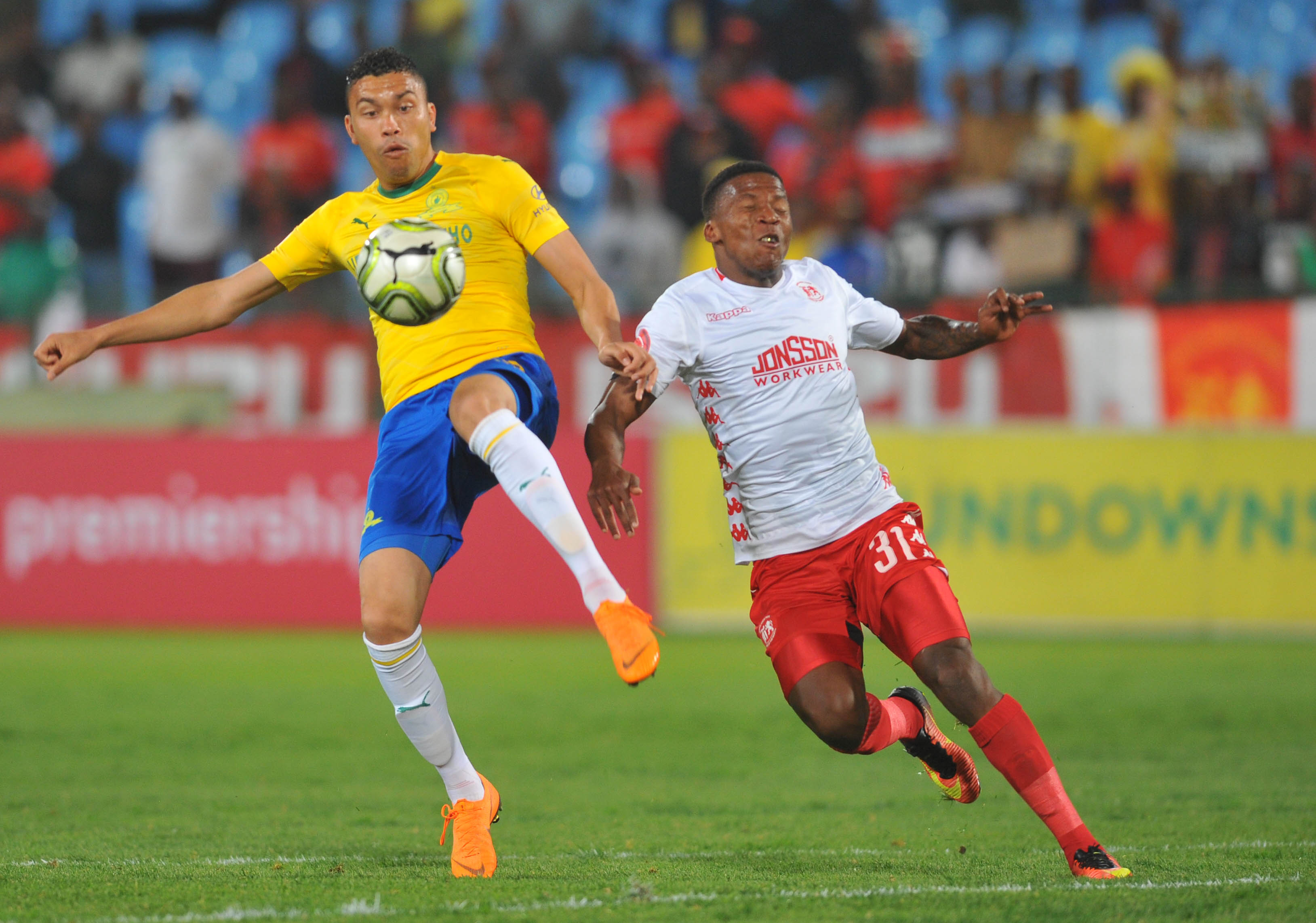 Ricardo Nascimento is challenged by Sabelo Nyembe