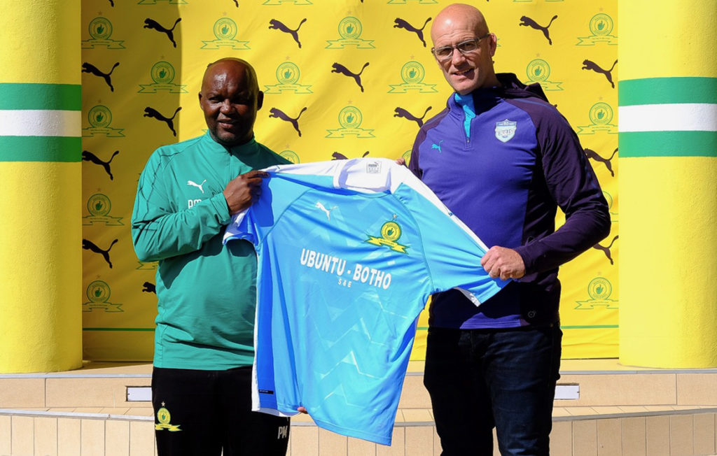fc86ea1f021 Mamelodi Sundowns coach Pitso Mosimane hands the new kit to Bulls coach  John Mitchell