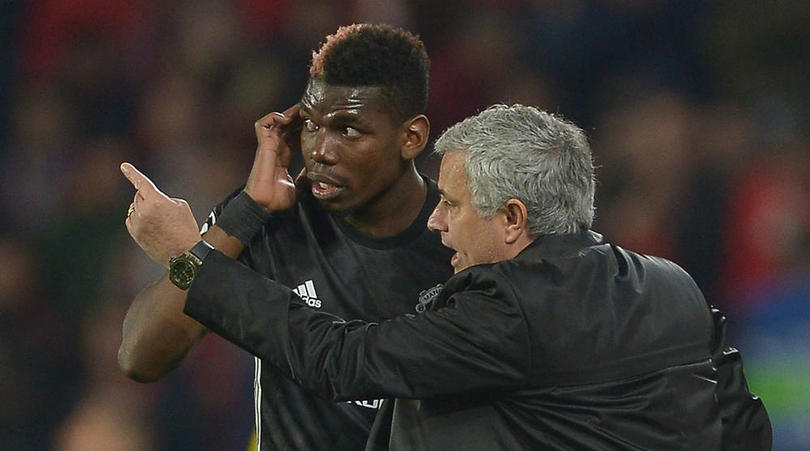 Paul Pogba and Jose Mourinho of Manchester United.