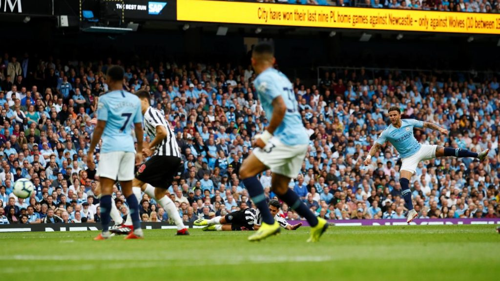 Man City edge out determined Newcastle