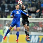 Bradley Grobler of Supersport United challenged by Xola Mlambo of Orlando Pirates