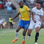 Mosa Lebusa of Mamelodi Sundowns shields Matthew Rusike of Cape Town City