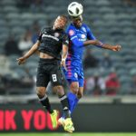 Reneilwe Letsholonyane of Supersport United challenged by Thabo Matlaba of Orlando Pirates