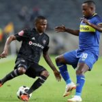Thembinkosi Lorch of Orlando Pirates challenged by Ayanda Patosi of Cape Town City.