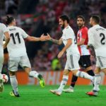 Holders Madrid cruise past Roma