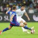Dean Furman, of Supersport United challenges Roland Putsche of Cape Town City