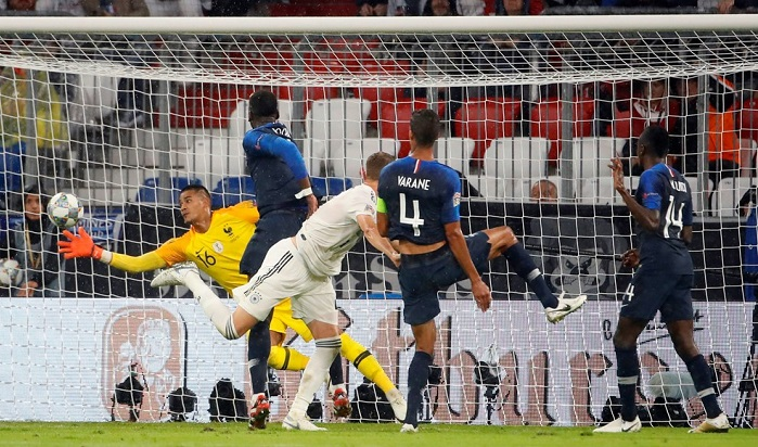 Alphonse Areola of France saves a header from Matthias Ginter of Germany in their Uefa Nations League opener.