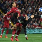 Virgil van Dijk of Liverpool and Edinson Cavani battle for the ball.