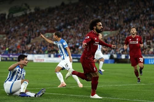 Salah guides Liverpool past Huddersfield