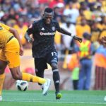 Augustine Mulenga of Orlando Pirates challenged by Mario Booysen of Kaizer Chiefs