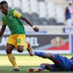 Siboniso Conco of Golden Arrows tackled by Onismor Bhasera of Supersport United