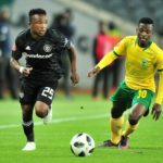 Paseka Mako of Orlando Pirates challenged by Siboniso Conco of Golden Arrows