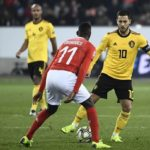 Eden Hazard of Belgium and Edmilson Fernandes of Switzerland