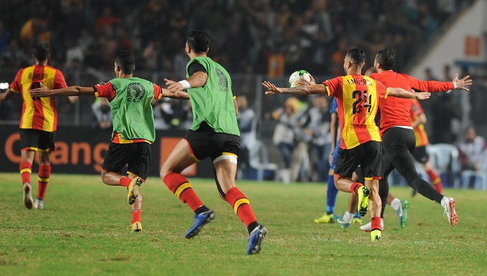 ES Tunis players celebrate winning the Caf Champions League