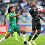 Ben Motshwari of Orlando Pirates challenged by Siyethemba Sithebe of AmaZulu