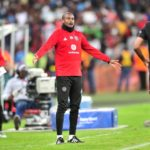 Xola Mlambo of Orlando Pirates celebrates his extra-time goal with assistant coach Rhulani Mokoena