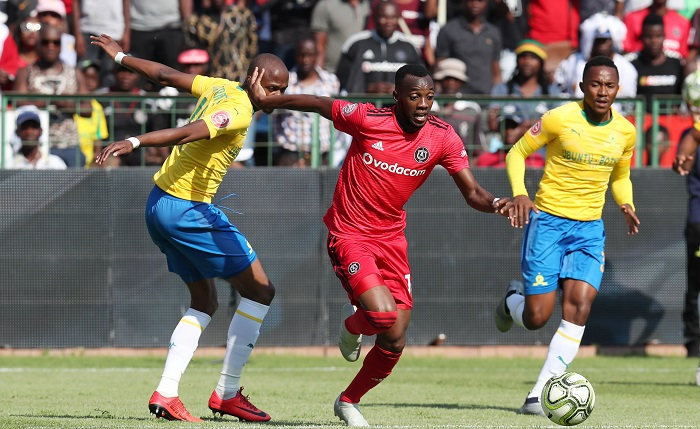Justin Shonga of Orlando Pirates challenged by Tebogo Langerman of Mamelodi Sundowns