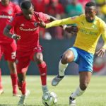 Lebohang Maboe of Mamelodi Sundowns challenges Innocent Maela of Orlando Pirates