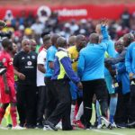 Pitso Mosimane, coach of Mamelodi Sundowns argues with referees and Orlando Pirates technical staff