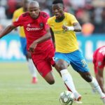 Phakamani Mahlambi of Mamelodi Sundowns challenged by Xola Mlambo of Orlando Pirates