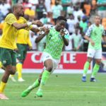 Ahmed Musa of Nigeria challenged by Tiyani Mabunda of Bafana Bafana