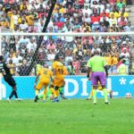 Justin Shonga of Orlando Pirates score a goal passed Itumeleng Khune of Kaizer Chiefs
