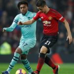 Ander Herrera of Manchester United and Alex Iwobi of Arsenal