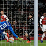 Lacazette on target as Saka shines