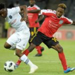 Paseka Mako of Orlando Pirates challenged by Mario Ravo of Light Stars FC